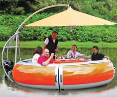 This is the boat with a built-in barbecue grill, umbrella, and trolling motor that provides waterborne cookouts for up to 10 adults.The Barbecue Dining Boat - Hammacher Schlemmer.The New Barbecue Dining Boat. Electric Trolling Motor, Electric Motor, Kombi Motorhome, Hammacher Schlemmer, My Pool, Pool Fun, Looks Cool, Outdoor Fun, Outdoor Twister