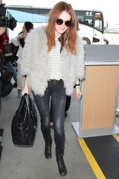 Julianne Moore steps out in the perfect winter outfit:  skinny jeans, a striped tee and a chubby gray fur jacket. Shop her look here: c
