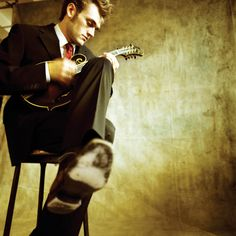 Chris Thile of such great bands as Nickelcreek and Punch Brothers. If you haven't seen him play that mandolin, you need to. It will change your life.