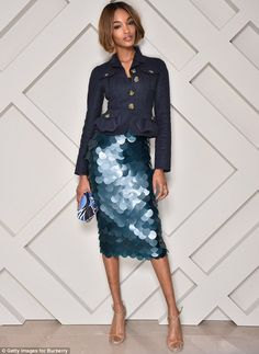 True blue: The stunning model wowed in a skirt featuring large blue sequins with a navy pe...