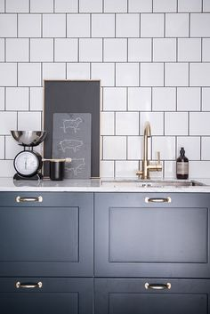 Loving these square white tiles, it adds a different element to the traditional rectangular tiles