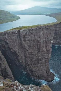 Lake Sorvagsvatn / Leitisvatn in the Faroe Islands, Denmark. While the Lake does hang above the ocean, the distance is actually only 30 mtrs.