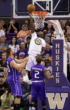 Nate Robinson, top, touches in a layup during the University of Washington Alumni Game