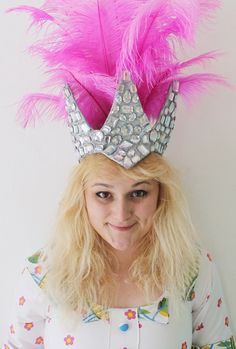 Make a feather showgirl headdress hat to rock at your NYE party with this tutorial.