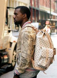 Kanye West wears a Louis Vuitton Damier Azur Canvas Mountaineering Backpack