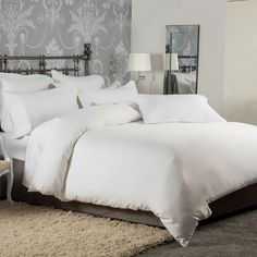 Our 1200 Thread Count range has been developed to simply be the best you can buy. Made from superior fine yarns of long staple cotton, this luxurious range is what you will find in the best hotels around the globe. Supreme quality made of pure cotton that is so smooth against your skin and drapes across your bed with elegance and style. Indulgent, soft an long lasting we call it our 7 star collection.