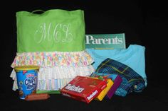 "This personalized canvas tote (13"" x 13"") with three rows of ruffles, comes with some of the little things a new mom might enjoy while in the hospital. Includes bag (with ruffles and embroidery), 3 boxes of candy, pj pants, T-shirt, cookies..., thank you notes (your choice boy or girl) and a new pen, and a bag of microwave popcorn. Since everything I do is custom, be sure to message me if you would like to make some changes to the content or if you have any questions."