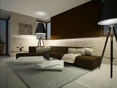 Zaproponowany projekt wnętrz mieszkania pozostaje w klasycyzującym duchu ciepłych odcieni bieli i szarości. Podświetlenie liniowe kamienia w połowie ściany i przełamanie kolorze czekolady stało się doskonałym tłem dla prostej formy […]