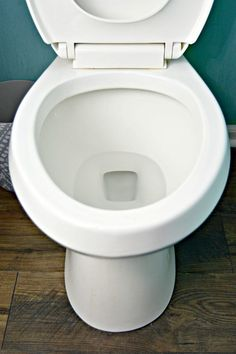 Removing hard water stains from your toilet is easy to do with vinegar and baking soda. You just need a few minutes and a little elbow grease.