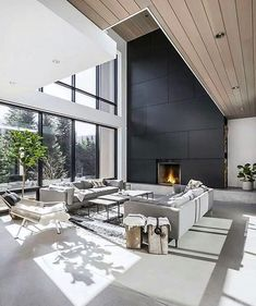 High ceilings, black cladding, timber - my Sunday interior happiness. Living room goals. Image courtesy of @mod.homes