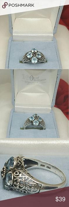 QVC Epiphany Blue Topaz Filigree Ring Vintage QVC Epiphany Blue Topaz/Aquamarine  ( not sure which) Sterling silver ring. Size 8 . This is a Pre-owned item and has normal wear and tear,  but as you can see by the pics, still gorgeous! QVC Epiphany Jewelry Rings