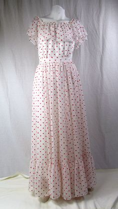 Whimsical, pretty, feminine Red Dotty dress from the early 1960's. See it on our website!