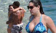 Kelly Brook turns heads in plunging blue bikini on Mykonos beach