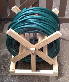 The shed and beyond.: Allotment update & a homemade hose reel ... ... Garden Hose Storage, Garden Hose Holder, Garden Hose Reels, Scrap Wood Projects, Woodworking Projects, Garden Projects, Water Hose, Wooden Diy, Wood Turning