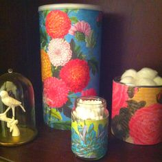 Scrapbook paper plus oatmeal canister, formula can, and baby food jar.