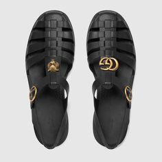 Shop the Rubber buckle strap sandal by Gucci. A strap sandal in rubber is embellished with Double G hardware on one shoe and metal feline head on the other. Buy Shoes, Men's Shoes, Dress Shoes, Basket Style, Gucci Brand, Black Leather Shoes, Baskets, Custom Shoes, Black Rubber