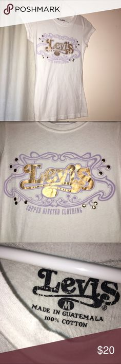 "Levi's Logo Tee Medium Cap sleeves white tee shirt with Levi's logo in Copper lettering and lavender. Adorable! Size M, "" Copper Riveted Clothing."" Awesome for Levi's display. Levi's Tops Tees - Short Sleeve"