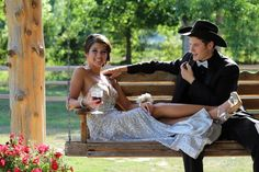 Prom picture pose couple poses dress hair love happy hat cowboy swing outside outdoors sequin suit tie