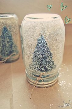 glue dollar store tree to lid, fill jar 1/4 of the way with fake snow and 3/4 with water. stick lid on with tree attached, voila! homemade snow globe. cheap and easy, cute christmas gifts. add ribbon or twine onto lid for added effect.