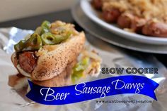 Slow Cooker Beer Sausage Dawgs are slow simmered in the crock pot with beer, sauerkraut and brown sugar to give it a rich and amazing depth of flavor. Slow Cooker Recipes, Crockpot Recipes, Cooking Recipes, Crockpot Dishes, Oreo, Sauce Barbecue, Bbq, Crock Pot Cooking, Freezer Cooking