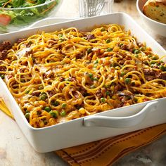 Church Supper Spaghetti Recipe -Because this recipe feeds so many, I often take it to church dinners and potlucks. This colorful dish also comes in handy when we have lots of help to feed on our farm. —Verlyn Wilson, Wilkinson, Indiana