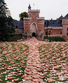 Human Art by  photographer Spencer Tunick.      Performance art, sociopolitical activism, design and photography came together to subvert the dominant paradigm in art of the nude with compositions of hundreds and thousands of naked subjects in a single composition, which become the landscape themselves.