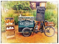Ice Cream Tricycle ready to go at the Barn at Bury Court, in the garden. Ice Cream wedding. Ice cream bicycle