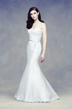 Paloma Blanca. Description: Silk Dupioni bridal gown. Cross-over tunic pleated bodice with pleaded straps. Gathered skirt. Sweep Train.   Forever Amour Bridal (212) 486- 2900 www.ForeverAmourBridal.com New York, New York 10022