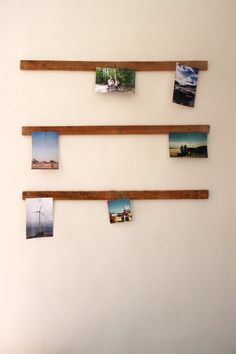 Display photos with timber rails, nails and paper clips. Julie & Jesper's Scandi-Canadian Nest on Apartment Therapy