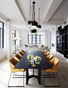 A modern dining space with industrial light fixtures