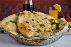 Make this quick and easy #naan breads flavored with garlic and fresh coriander and brush it with butter. Serve them hot!