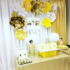 beautiful gold yellow and white paper flowers for the cake table