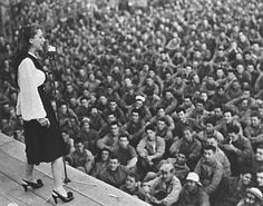 Dinah Shore, a popular singer on the music charts of her day, traveled with USO tours in Europe to entertain the troops; 1943 or so.