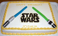 Star Wars cake for a friend's little boy. The light sabers are all MMF and the Star Wars logo is FBCT.