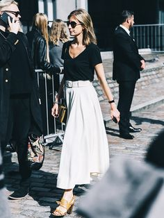 How to Wear a Maxi Skirt Without Looking Dated via @WhoWhatWear: Style Tip: Keep it stylishly simple with a V-neck tee, belted skirt, and chunky sandals.