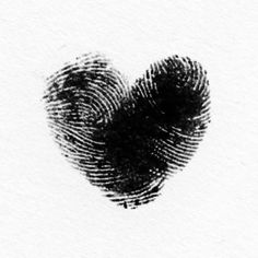 two finger prints made into a heart