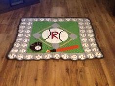 La couverture de baseball que j ai tricoter pour mon petit fils