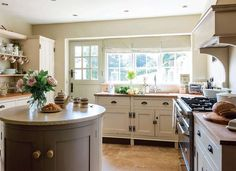 Modern Country Style: House Tour: Small Country Cottage Click through for details.  Warm white kitchen