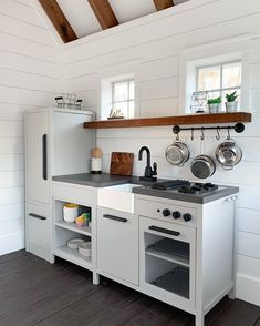 Take a second look.is it a real kitchen or a hacked Hearth and Hand kids play kitchen! did a beautiful job with… Inside Playhouse, Playhouse Decor, Playhouse Interior, Build A Playhouse, Playhouse Outdoor, Modern Playhouse, Under Stairs Playhouse, Girls Playhouse, Playhouse Ideas