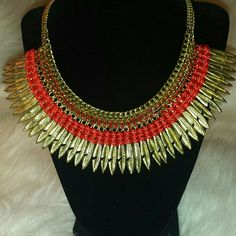 Statement Necklace Very trendy necklace with feather and red stone accents.  So cute!  Ready to be worn.  PRICE FIRM!   Necklace is approx. 16 in. with a 3 in extender Jewelry Necklaces