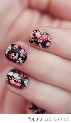 Spring floral on black background nail design