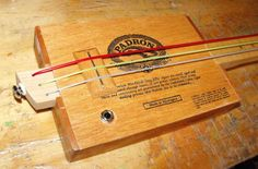 Cigar box bass guitar using weed wacker strings. (there's a video in the link)