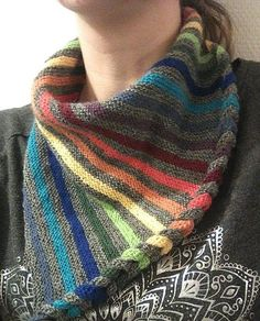 Free Knitting Pattern for DaPunzel Scarf - Triangle shaped scarf with braided edge and stripes that are perfect to use up scrap yarn. Fingering yarn. Designed by Finja Hansen. Available in German and English, but the English is not always clear, so you mi
