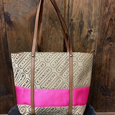 """Coach skinny double handle purse Khaki color with wide pink stripe. 13""""W x 10"""" L. In great condition Coach Bags Totes"""