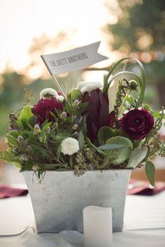white dahlias and burgundy ranunculus