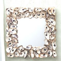 "Oyster Bay Shell Mosaic Wall Mirror – Our beautiful Oyster Bay Shell Mosaic Wall Mirror is the perfect accent for your beach home. Hang it any room to bring a touch of the sea indoors; 19"" W x 19"" H"