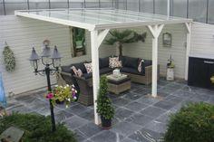 tuin tips en inrichting - mooie terras tegels en overkapping