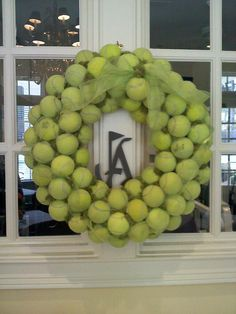 Great idea for recycling old tennis balls! A unique wreath for tennis fanatics. #upcycling #cliffdrysdaletennis