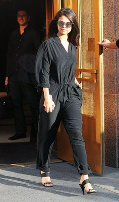 Selena Gomez wears her simple black strap mules with almost everything Black Jumpsuit, Silk Jumpsuit, Selena Gomez Nails, Selena Gomez Outfits, Selena Gomez Style, Celeb Style, Her Style, Cool Style, Iconic Women