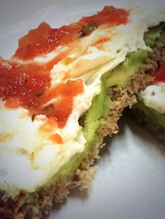 Yummy organic breakfast sandwich! Ezekiel bread buttered with 1/4 avocado. Add 2 cooked egg whites & top with your favorite salsa ( I used a mango salsa). Et voila ! Delicious !